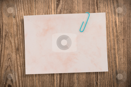 Paper noteon old table, clipping path. stock photo, Paper note with clip on old wooden table, clipping path. by Pablo Caridad