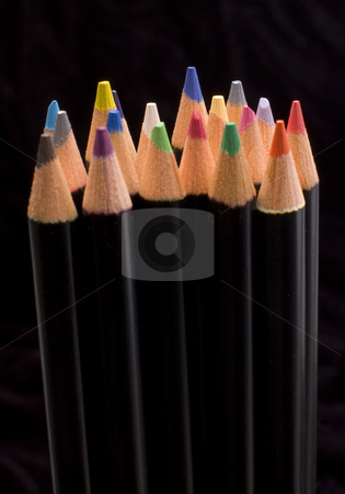 Colored pencils stock photo, Colored pencils lined up on a black background by Jonathan Hull