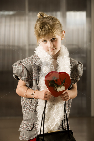 Cute young girl with Valentine stock photo, Cute young girl in dress-up clothes with Valentine by Scott Griessel