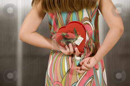 Girl with Valentine stock photo, Little girl holding a Valentine behind her back with fingers crossed by Scott Griessel
