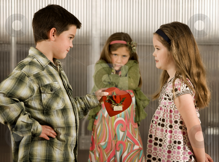 Valentine Gift  stock photo, Little boy giving a candy heart to girl causes anger by Scott Griessel