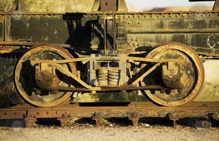 Antique train wheels stock photo, Antique train wheels on an old track by Scott Griessel