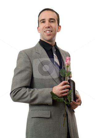 Formal Man stock photo, Young man wearing a suit and tie, holding a single rose and a bottle of champagne by Richard Nelson