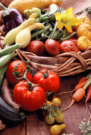Fruits and vegetables stock photo, Vegetables and fruits spilling out of a basket by Jonathan Hull