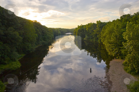 The River at Sunset stock photo, A glorious view of the Farmington River around dusk.  A patient fly fisherman is seen enjoying his hobby. by Todd Arena