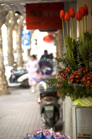 Flowers on the road stock photo, Bounch of fresh flowers on shanghai  road  dof by Francesco Perre