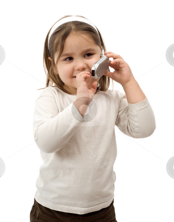 Toddler On Cell Phone stock photo, A young child using a cell phone, isolated against a white background by Richard Nelson