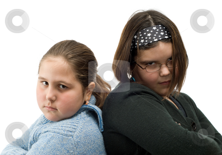 Cool Girls stock photo, Closeup of two girls standing beside eachother with their arms crossed, trying to look cool by Richard Nelson