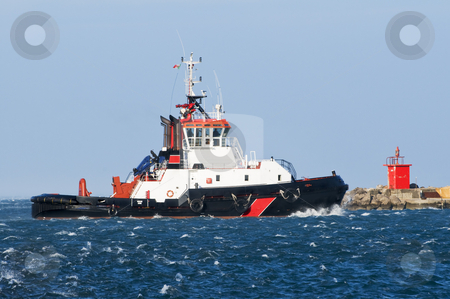 Tug boat stock photo, Tug boat navigating in a rough sea by Massimiliano Leban