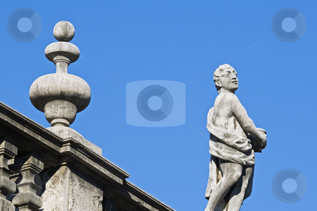Statue stock photo, Statue on nd frieze on a building rooftop by Massimiliano Leban