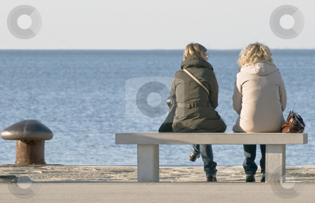Women talking stock photo, Two women chattin on a bench by Massimiliano Leban