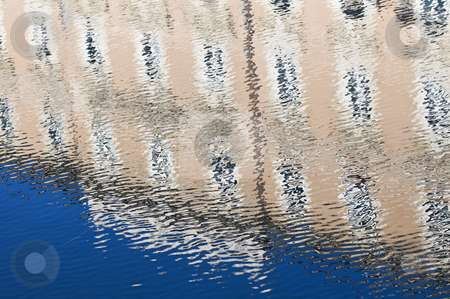 Water reflections stock photo, Building and blue sky reflected into the water by Massimiliano Leban