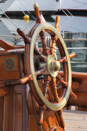 Rudder stock photo, Steering wheel on a wooden boat by Massimiliano Leban