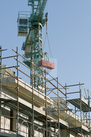 Contruction site stock photo, Detail of scaffolding and crane by Massimiliano Leban