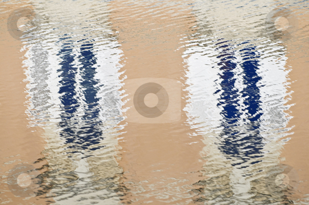 Water reflections stock photo, Windows of a building reflected into the water by Massimiliano Leban