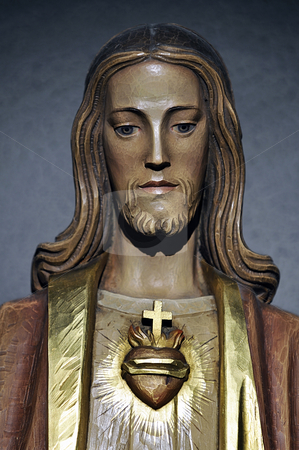 Jesus Christ stock photo, Painted wooden statue of Jesus Christ by Massimiliano Leban