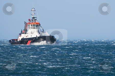 Tug boat stock photo, Tug boat navigating in a rough sea by Massimiliano Leban