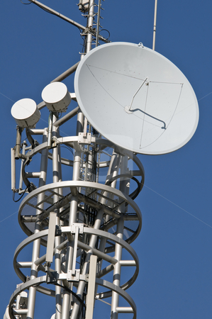 Antenna stock photo, Transmission mast with parabolic antenna against a blue sky by Massimiliano Leban