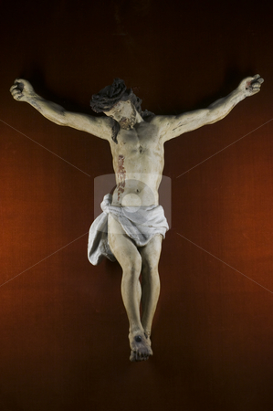 Christ stock photo, Wooden statue of Jusus Christ nailed on the cross by Massimiliano Leban