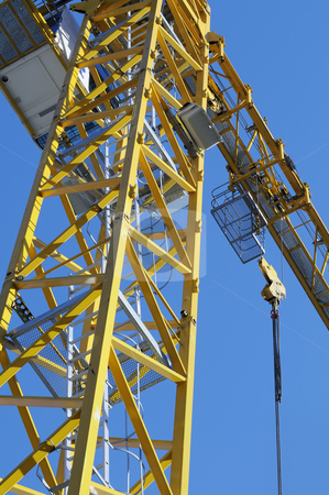 Crane stock photo, Detail of yellow crane in construction industry by Massimiliano Leban