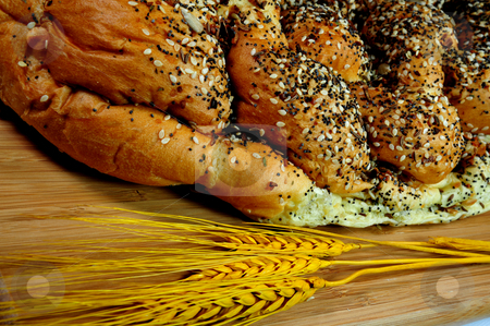 French Bread On A Cutting Board stock photo, A loaf of artisan french bread topped with assorted seeds by Lynn Bendickson
