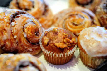 Banana Nut Muffin stock photo, Assorted sweet patries including cinnimon rolls and muffins by Lynn Bendickson