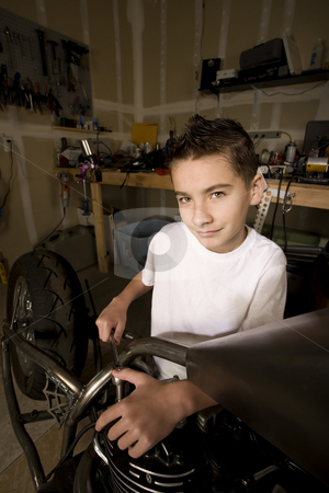 Boy Mechanic stock photo, Young Boy Mechanic Working on a Chopper Motorcycle by Scott Griessel