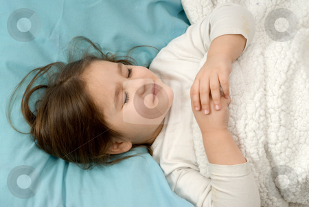 Sleeping Girl stock photo, A young girl sleeping on her back in a soft bed by Richard Nelson
