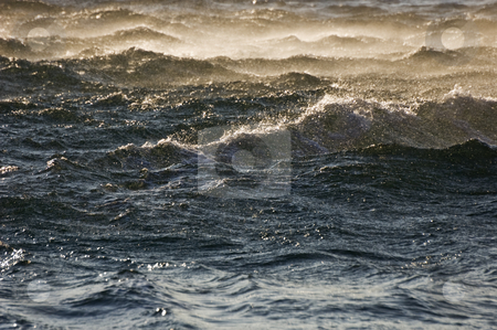 Rough sea stock photo, Waves on a dark blue sea at sunset by Massimiliano Leban