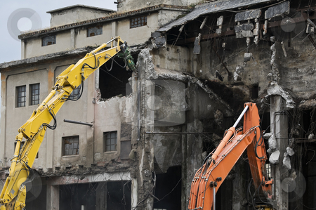 Building demolition stock photo, Machineries demolishing old industrial building by Massimiliano Leban