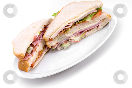 Club sandwich stock photo, A triple decker club sandwich on a white plate by Vince Clements