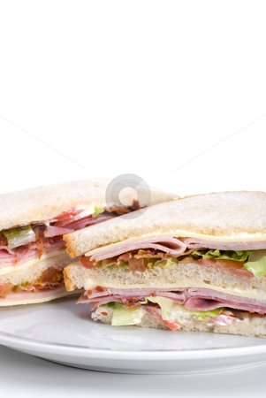 Club sandwich stock photo, A triple decker club sandwich on a white plate by Vince Clements