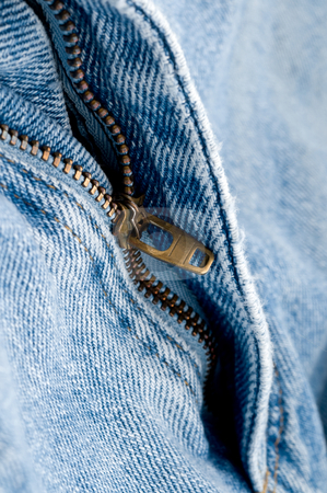 Macro of a brass zipper on blue jeans stock photo, Macro of a brass zipper on blue jeans by Vince Clements