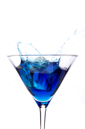 A cube od ice spalshing into a blue martini alcoholic beverage stock photo, A cube od ice spalshing into a blue martini alcoholic beverage by Vince Clements