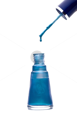 Dripping nail polish stock photo, Blue nail polish dripping from the applicator brush by Vince Clements