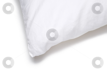 Corner edge of a white pillow stock photo, Corner edge of a white bed pillow on a white background by Vince Clements