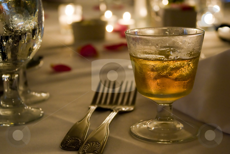 Scotch on the Rocks stock photo, A glass of golden hard liquor on the rocks. Could be scotch, bourbon, or whisky. by Todd Arena