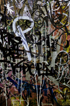 Abstract Graffiti Background stock photo, A heavily tagged wall. Grunge and messy. Cross-processed. by Dmytro Bershadskyy