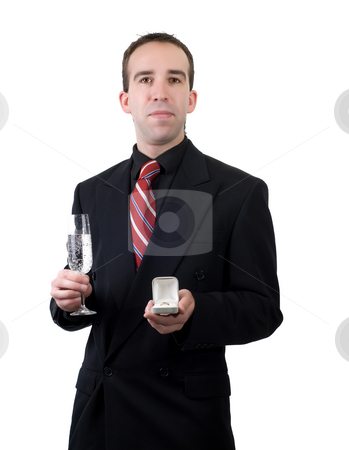 Showing Off Ring stock photo, A young man showing the ring he plans to propose with, isolated against a white background by Richard Nelson