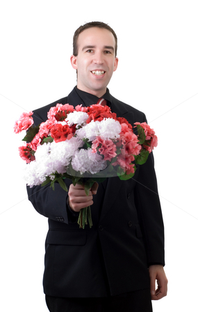 Man With Flowers stock photo, A young man wearing a suit, holding a bouquet of flowers, isolated against a white background by Richard Nelson
