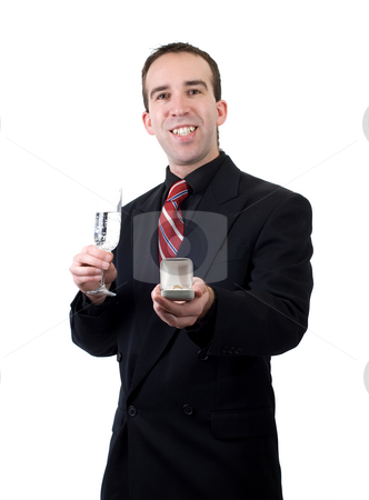 Marriage Proposal stock photo, An excited young man showing the ring he is going to propose with, isolated against a white background by Richard Nelson