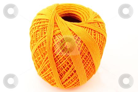 Orange wool clew stock photo, Orange wool clew on white background by Santiago Hernandez