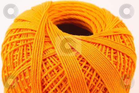 Orange wool clew2 stock photo, Orange wool clew on white background by Santiago Hernandez