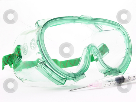 Goggles and syringe stock photo, Goggles and a sryringe and need on a white background by John Teeter