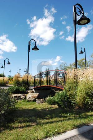 Nice park in the city.  stock photo, A nice park in front of a hotel in Montreal on a beautiful sunny day with an bridge over a small creek. by Horst Petzold