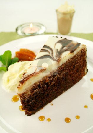 Slice Of Chocolate Cake stock photo, Rich chocolate cake with orange toffee and cream with a mint garnish. by Brett Mulcahy