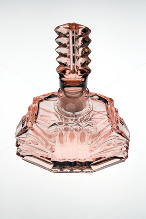 Pink antique perfume bottle stock photo, A glass perfume (scent) bottle, pink with decorative stopper by Paul Phillips