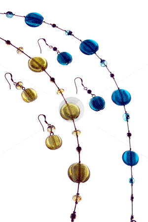 Matching stock photo, Matching earings and necklace in blue and yellow by Paul Phillips