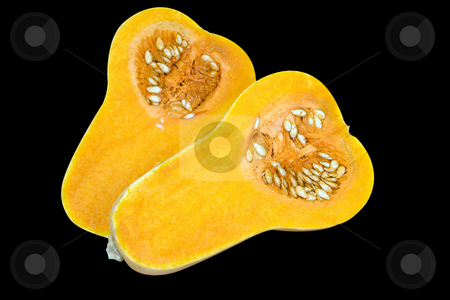 Raw Butternut stock photo, Butternut vegetable cut in half showing the bright orange flesh and seeds by Paul Phillips