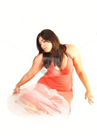 Woman sitting on the floor.  stock photo, An black haired young woman lying on the floor with in a pink dress and white twill over her body. by Horst Petzold
